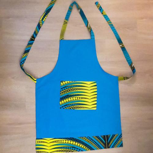 tablier de cuisine en tissu africain wax ou bogolan pour ménage et cooking. Tenue de travail et de divertissement.